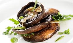 Vegan Portobello Steaks Foodservice Recipe using Cook's Delight® Roasted Garlic Flavor Concentrate with Garnish