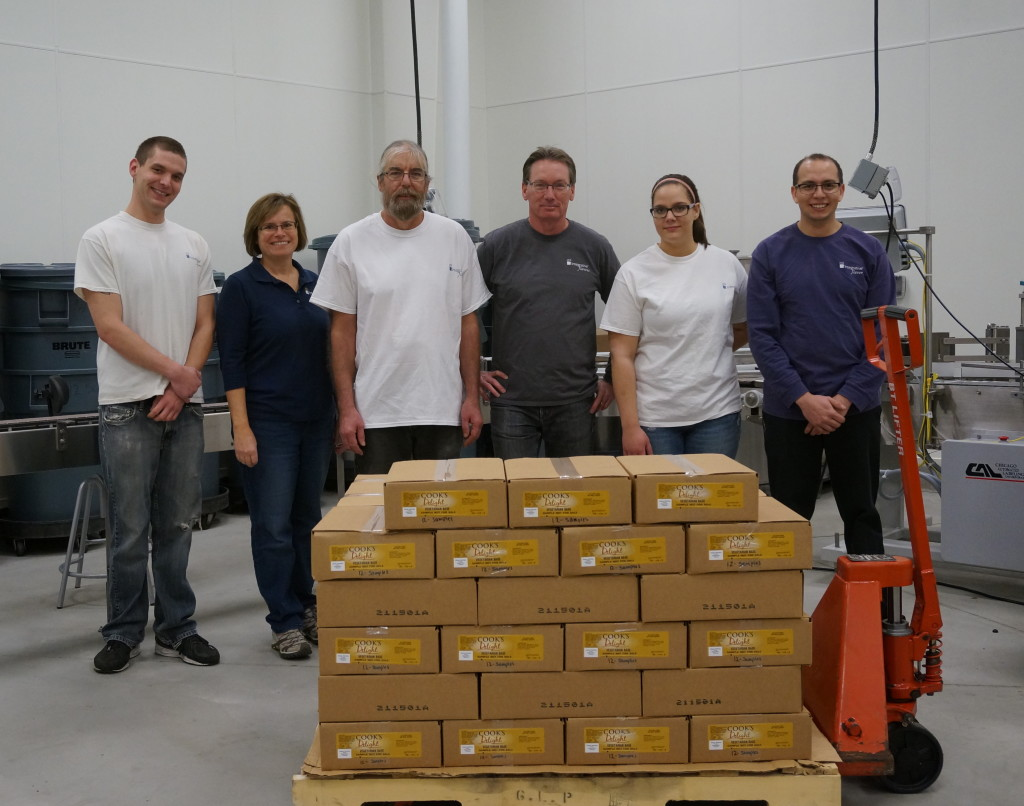 Integrative Flavors' Community Giveback Day 2015 packing Cook's Delight® soup base